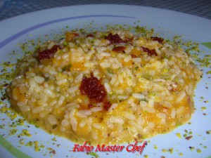 Risotto con Zucca Rossa, Pomodori Secchi sottolio e Pistacchio di Bronte