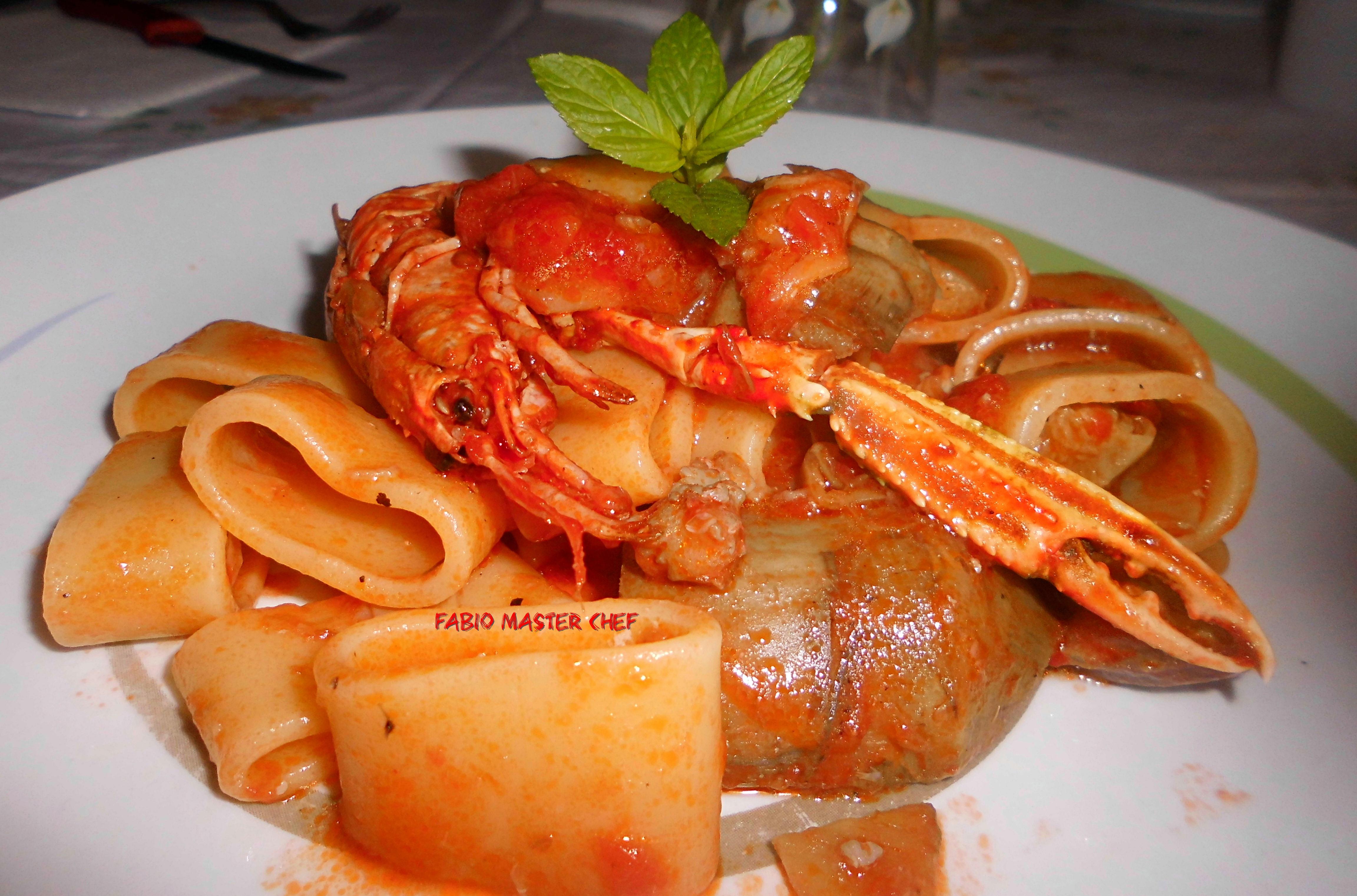 Calamarata con scampi e carciofi fabio master chef for Cucinare scampi